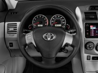 2013-toyota-corolla-4-door-sedan-auto-le-natl-steering-wheel