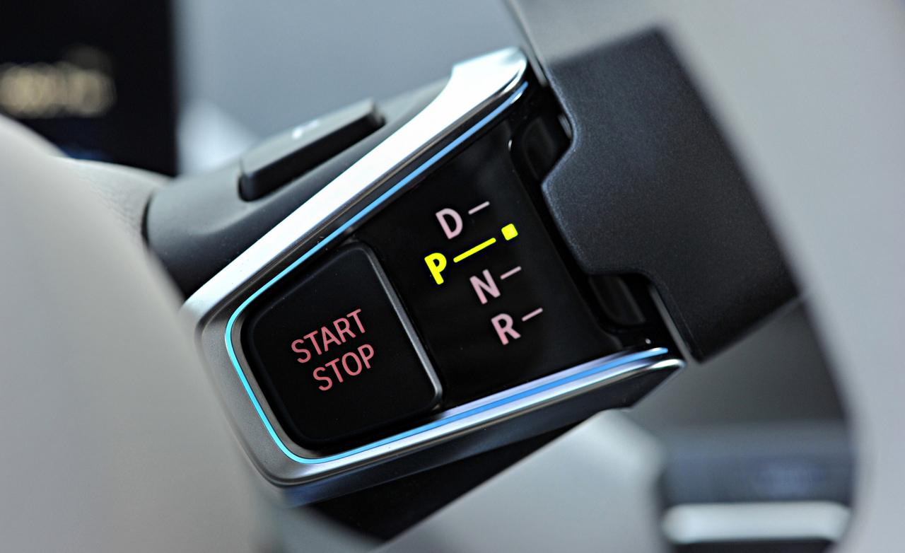 http://www.pedal.ir/wp-content/uploads/2014-bmw-i3-mega-world-engine-start-stop-button-and-electronic-shift-lever-7.jpg