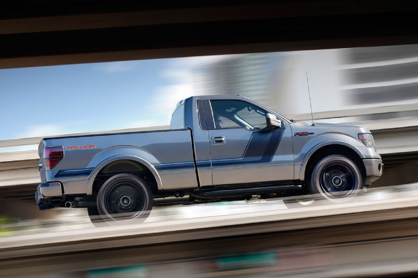 2014-ford-f-150-tremor-passengers-side-view-in-motion