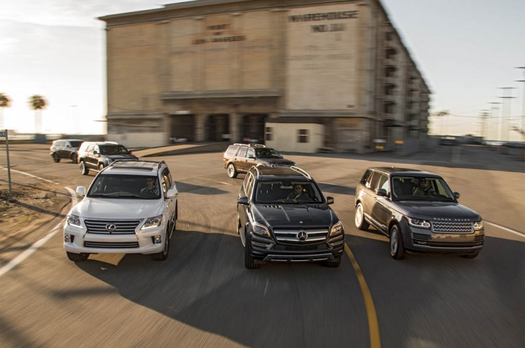 2015-large-luxury-suv-frot-end-in-motion