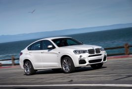 2016-BMW-X4-M40i-front-three-quarter-in-motion-23