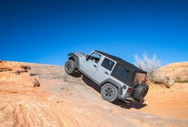 2016-Jeep-Wrangler-Unlimited-Rubicon-Hard-Rock-off-road-rear-three-quarter