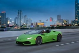 2016-Lamborghini-Huracan-Spyder-front-three-quarters-in-motion-03