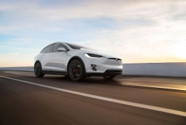 2016-Tesla-Model-X-P90D-front-three-quarter-in-motion-02