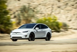 2016-Tesla-Model-X-P90D-front-three-quarter-in-motion-03-1