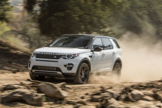 2015-Land-Rover-Discovery-Sport-HSE-front-three-quarters-in-motion-03
