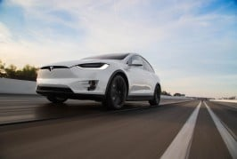 2016-Tesla-Model-X-P90D-front-three-quarter-in-motion-03