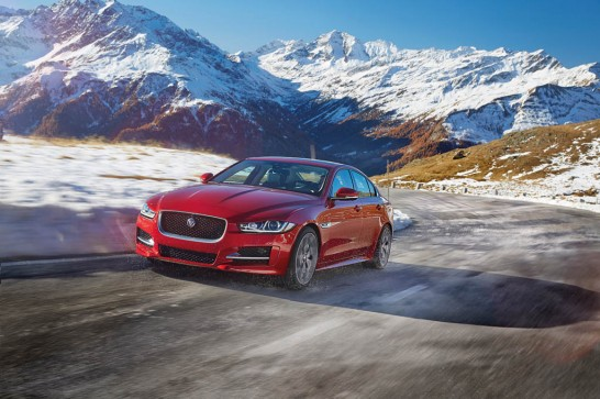 2017-Jaguar-XE-AWD-front-three-quarter-in-motion-02