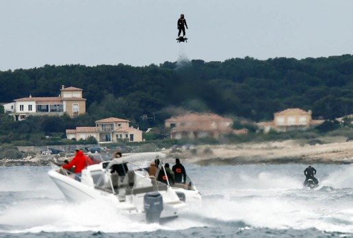 Pilot and jet-ski champion Franky Zapata hovers in the air on an IPU Flyboard Air hoverboard as he breaks the Guiness World Records for furthest flight by hoverboard in Sausset les Pins near Marseille, France