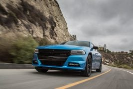 2016-Dodge-Charger-SXT-front-three-quarter-in-motion-03