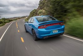 2016-Dodge-Charger-SXT-rear-three-quarter-in-motion