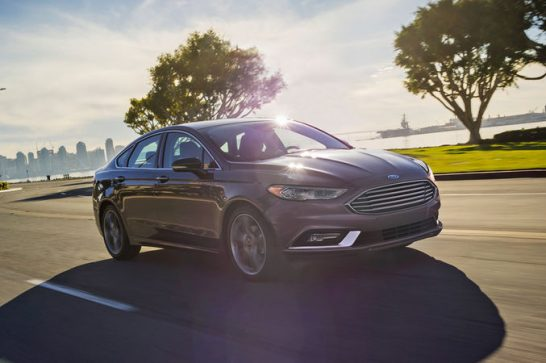 2017-Ford-Fusion-Hybrid-front-three-quarter-in-motion