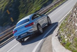 2017-Mercedes-Benz-GLC300-Coupe-rear-three-quarter-in-motion-01