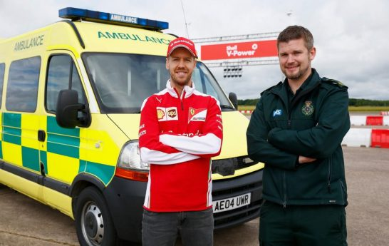 Sebastian-Vettel-With-Ambulance-And-Driver-2