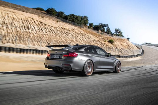 2016-BMW-M4-GTS-rear-three-quarter-in-motion