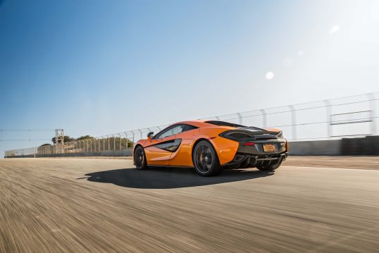 2016-McLaren-570S-rear-three-quarter-in-motion