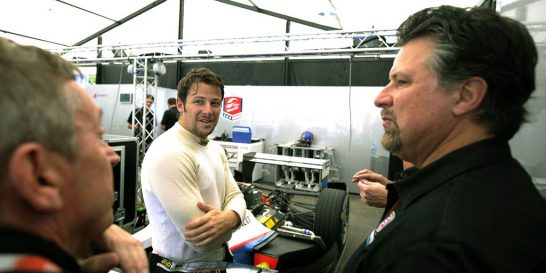 Michael Andretti (right) with son Marco