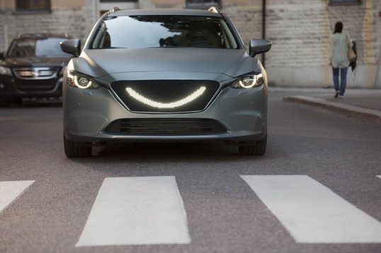 When-the-self-driving-carÔÇÖs-sensors-detect-a-pedestrian-a-smile-lights-up-at-the-front-of-the-car-and-the-car-stops