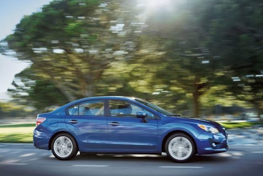 2014-subaru-impreza-passengers-side-in-motion