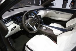 inside-the-concept-is-composed-of-a-mix-of-high-gloss-wood-and-plastic-the-center-console-comes-with-a-display-for-navigation-and-infotainment-but-also-shows-how-the-new-engine-is-performing