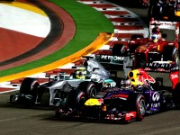 Seb Vettel and Nico Rosberg battle for the lead off the line